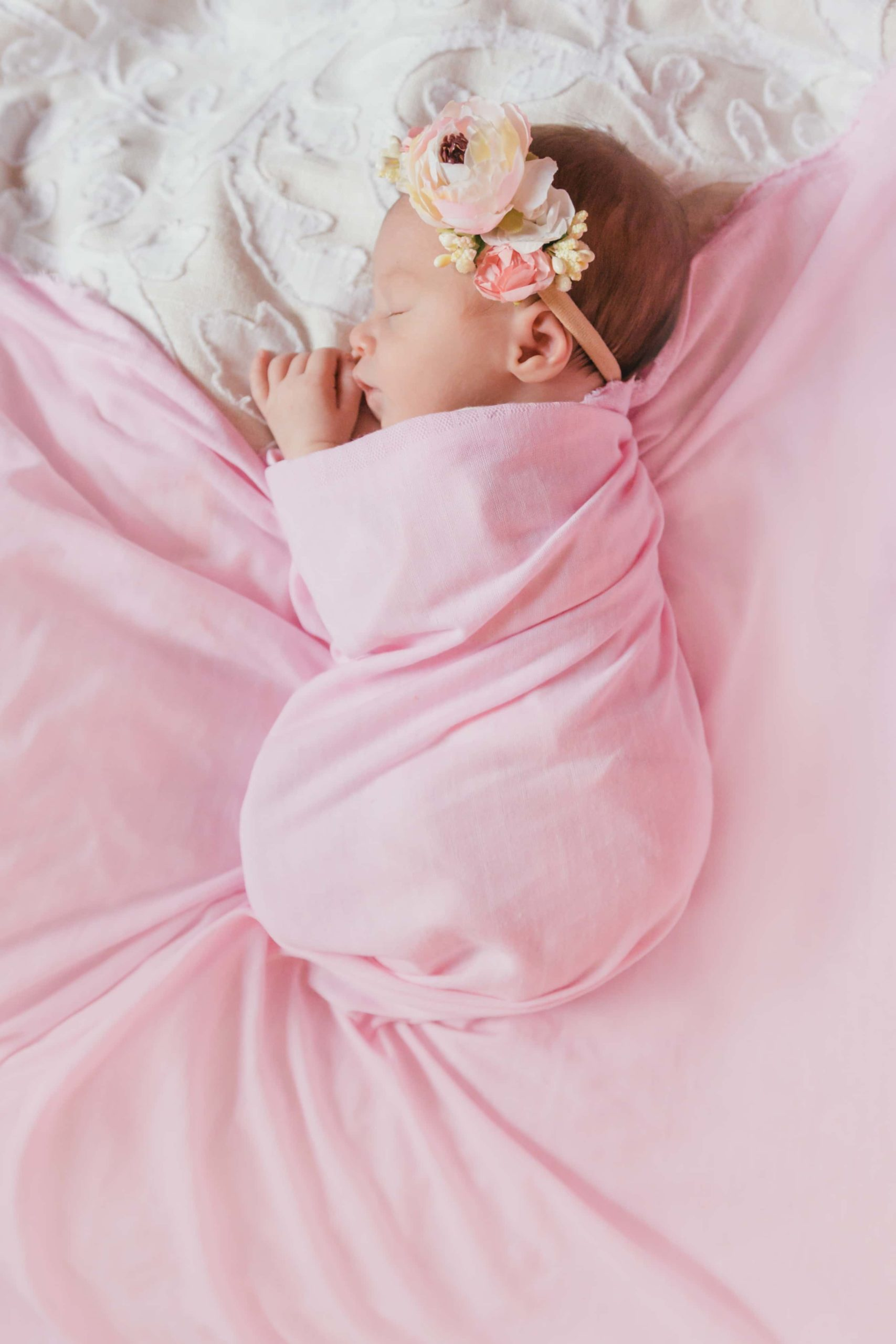 Atlanta Newborn Photographer Baby Girl in Soft Pink with FLowers