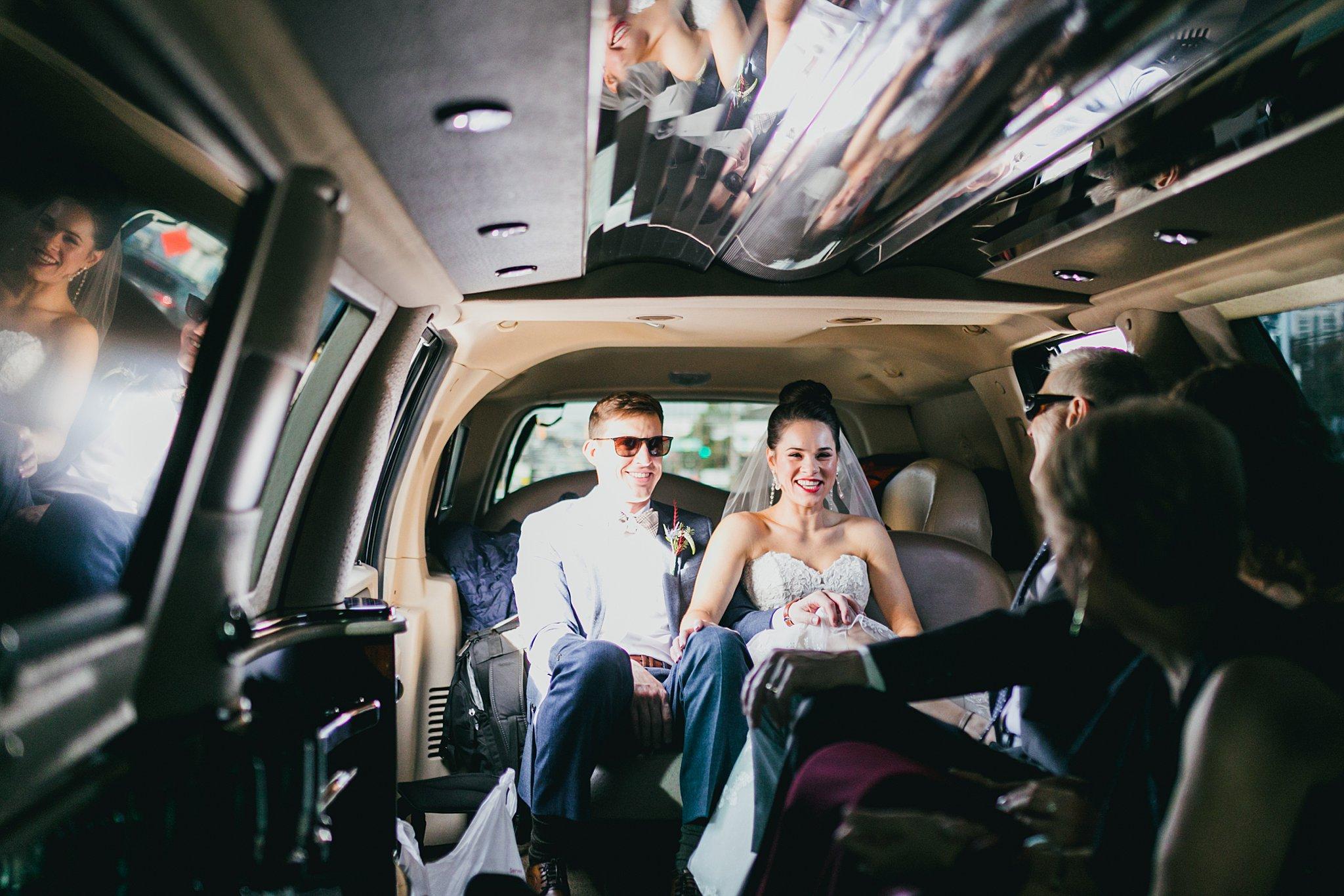 Atlanta Wedding Photographers Bride and Groom in Limo